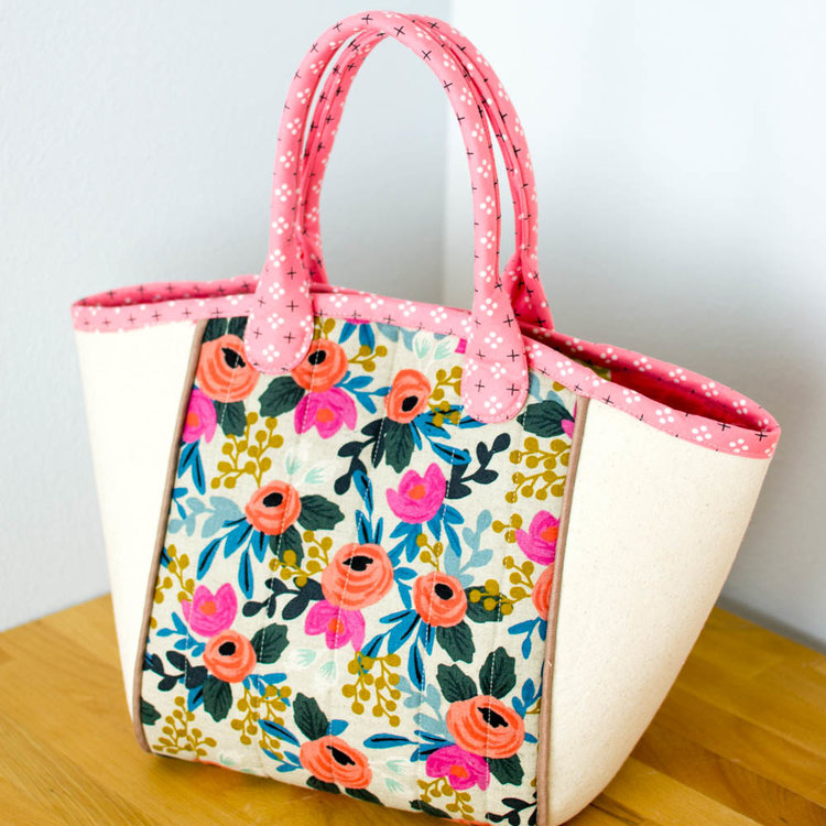 A floral tote sitting on a table