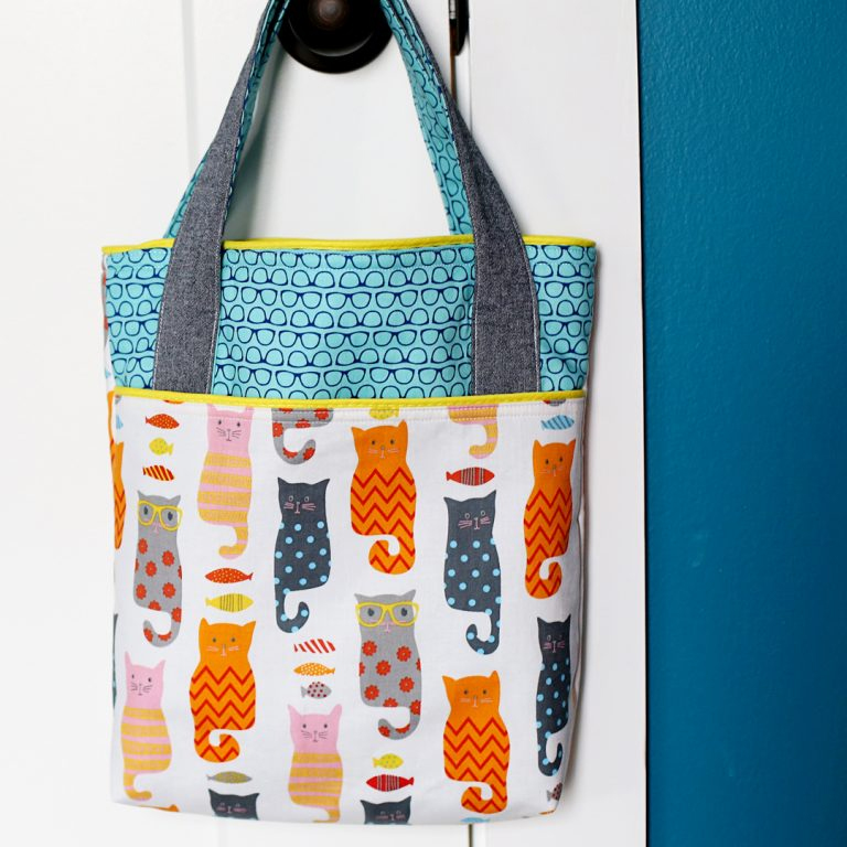 A tote bag handing on a doorknob
