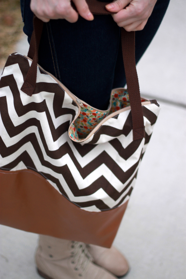 A chevron and leather tote bag