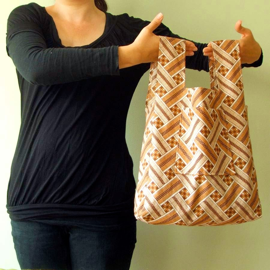 A woman holding a tote bag