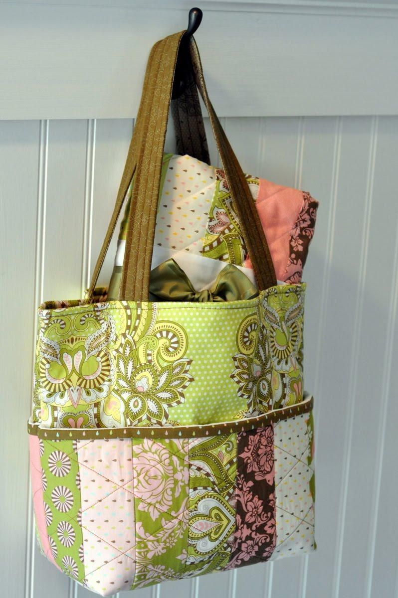 A quilted tote hanging from a hook