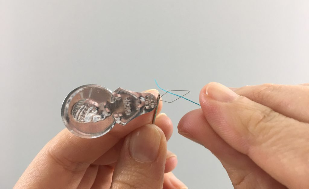 Inserting thread into a needle threader