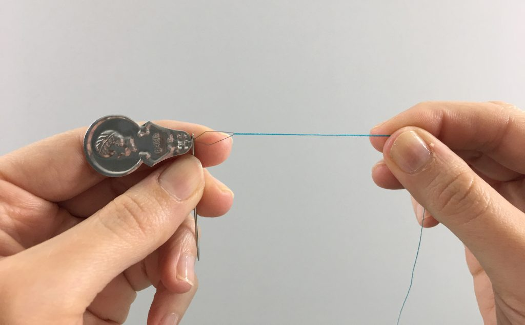 Pulled thread coming out of a needle threader