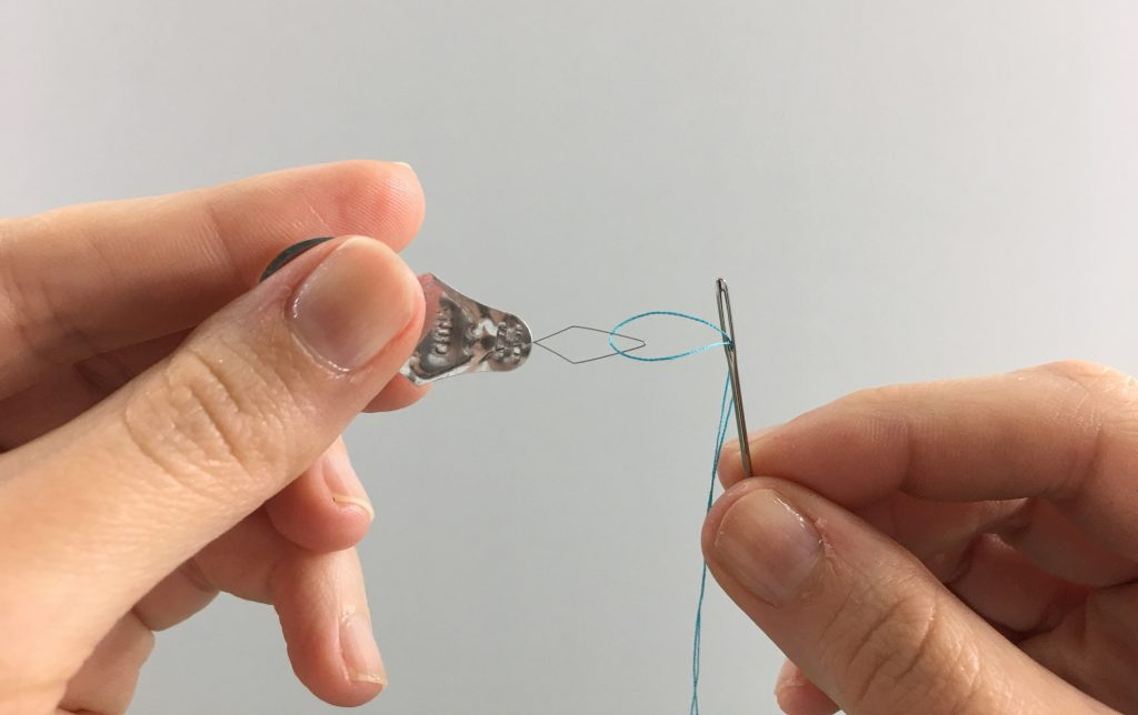 Threading a needle with a needle threader