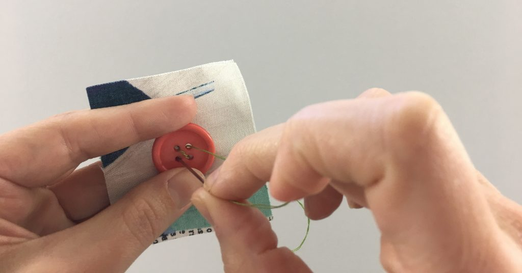 Making an X to sew on a button