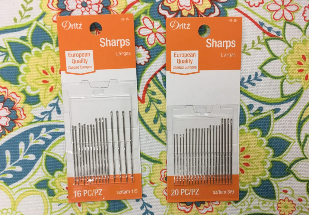 Two packages of Sharps hand sewing needles