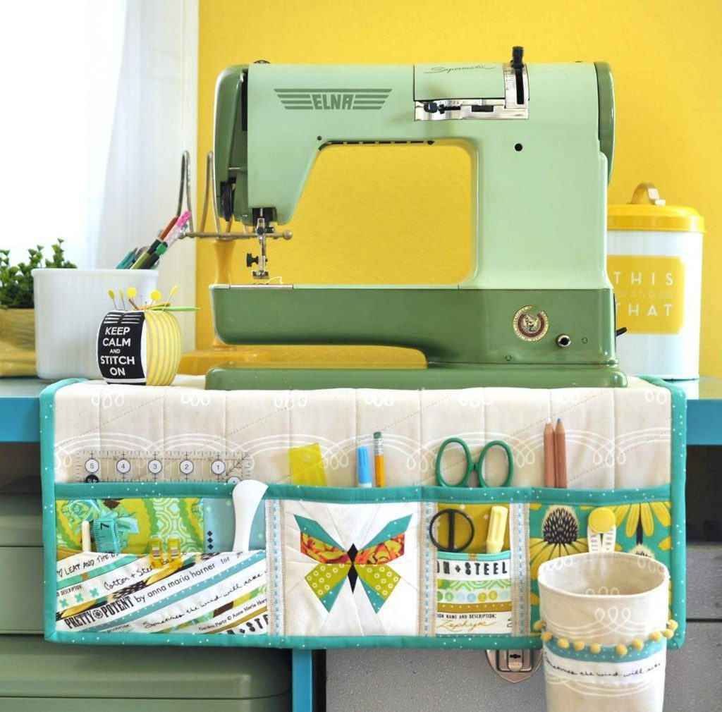 A sewing machine sitting on a mat with lots of pockets