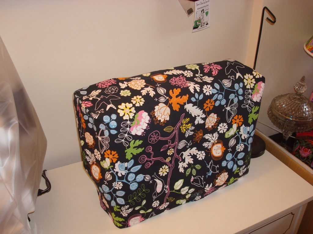 A floral sewing machine cover