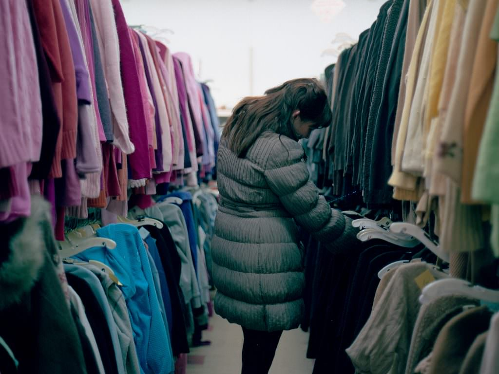 A woman shopping at a thrift store