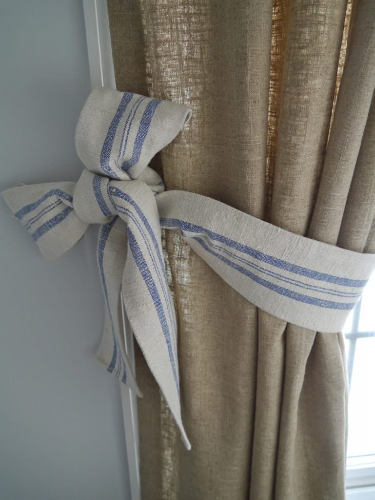 A ticking tie back added to drop cloth curtains