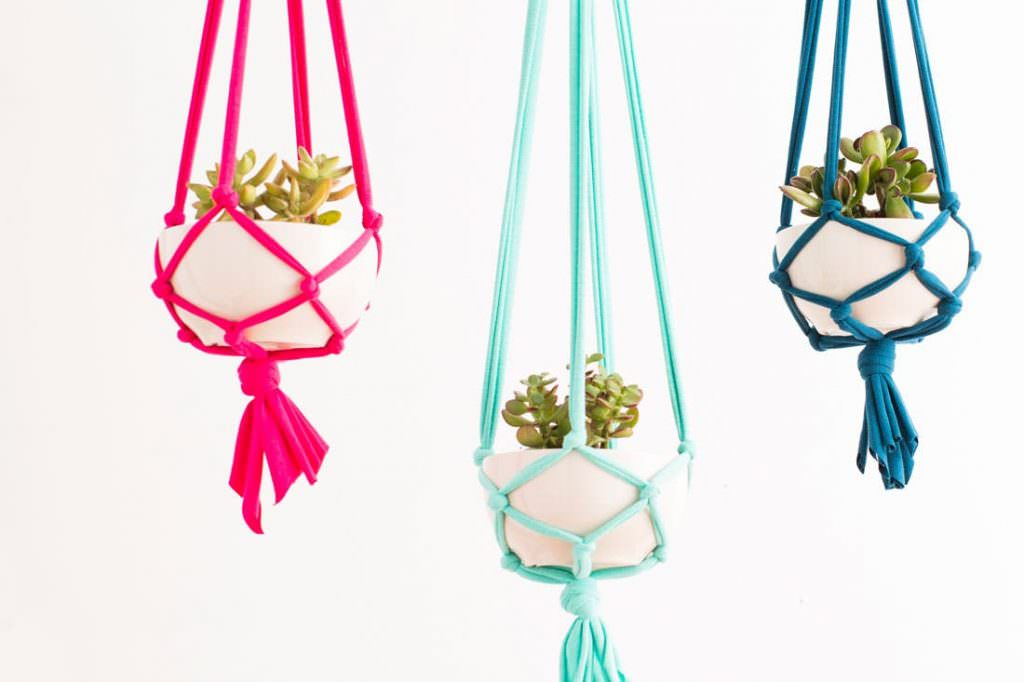 Three colorful macrame plant hangers