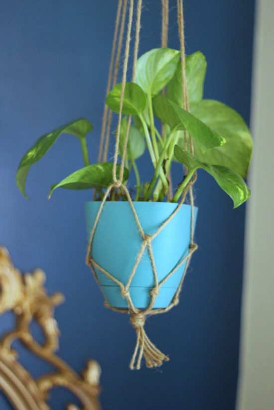 A macrame plant holder made of twine