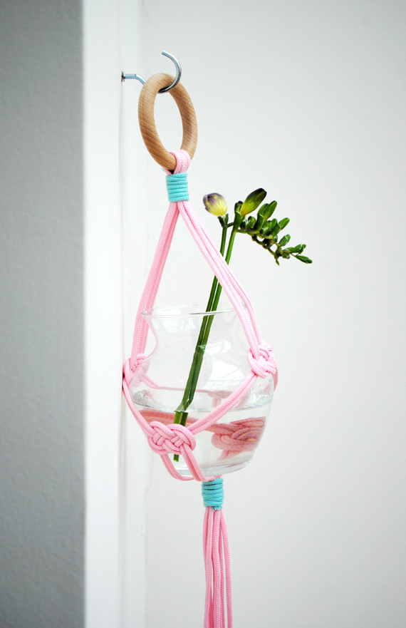 A pink and blue macrame vase holder